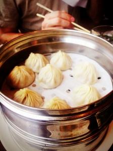 a tin steamer full of fresh xiaolongbao
